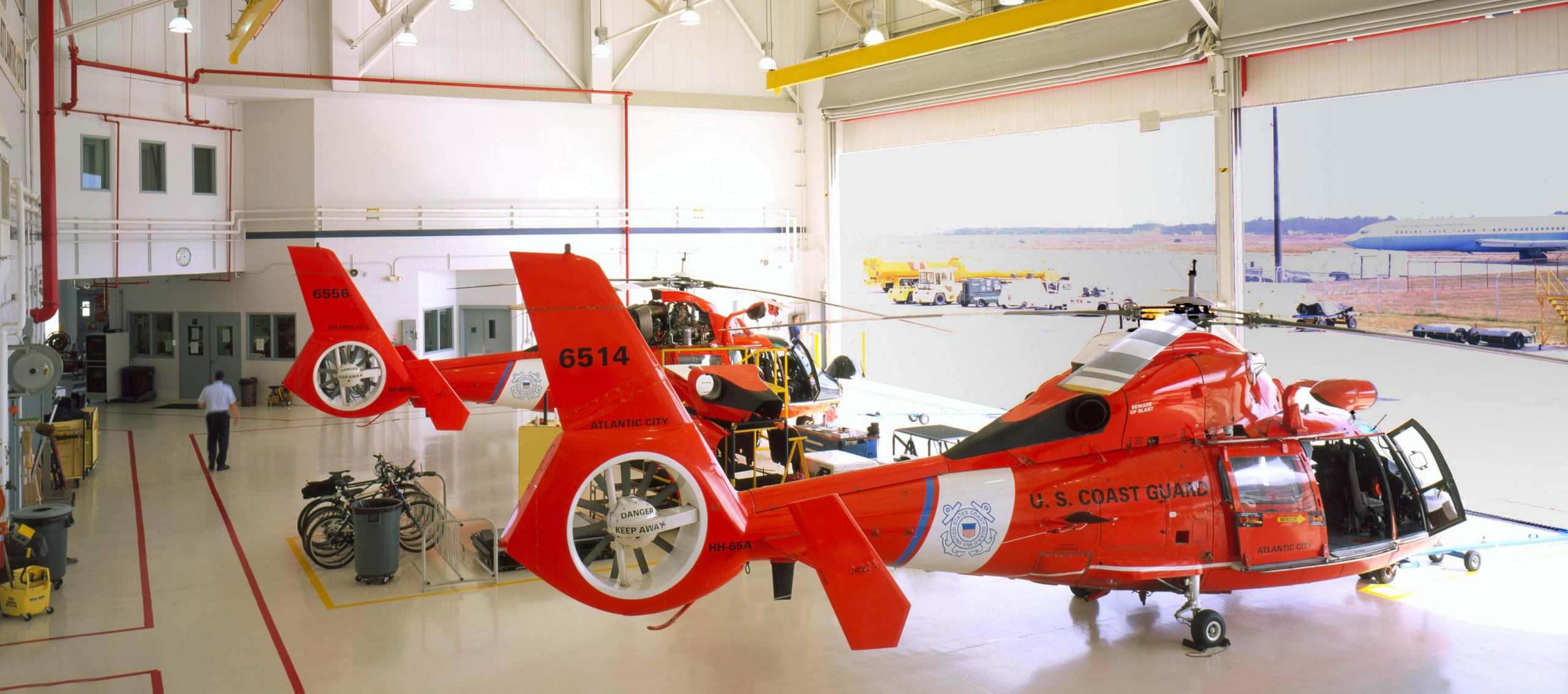 Coast guard helicopters in hangar